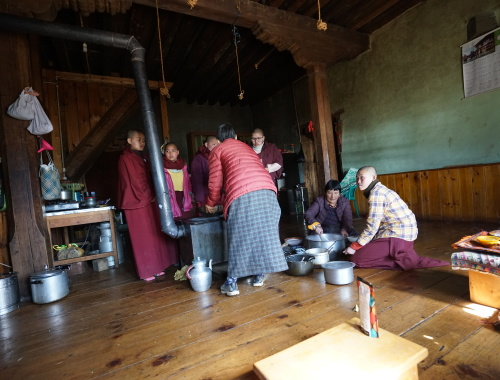 Nuns, family of the Lama and workers taking lunch in the house